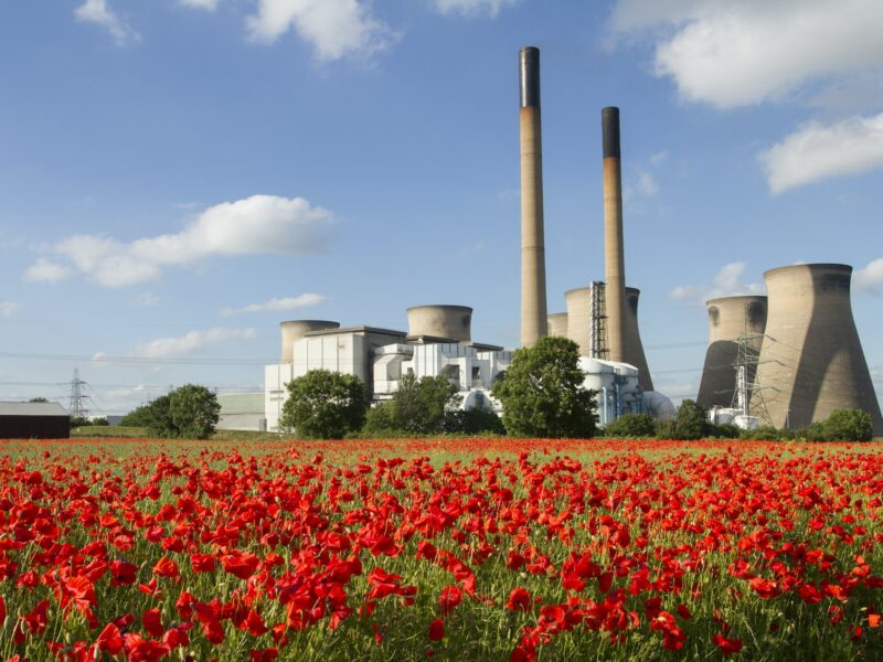 Ferrybridge Power station in England with a red poppy field in foreground